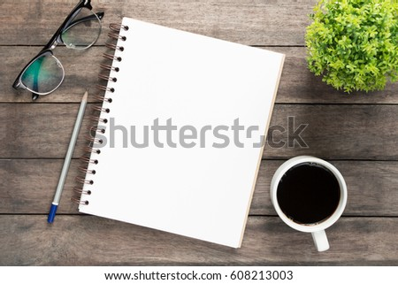 Office atable with blank notebook and laptop  /  Coffee cup #608213003