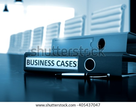 Office Binder with Inscription Business Cases on Wooden Desktop. Business Cases. Concept on Toned Background. 3D.