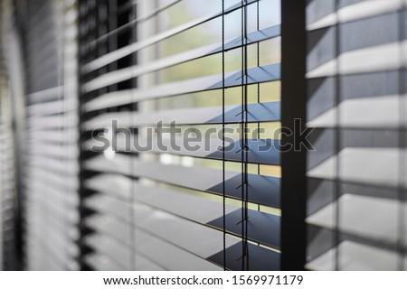 Office blinds. Modern wooden jalousie. Office meeting room lighting range control. Stockfoto ©