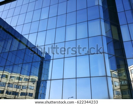 office building blue glass wall reflection detail
