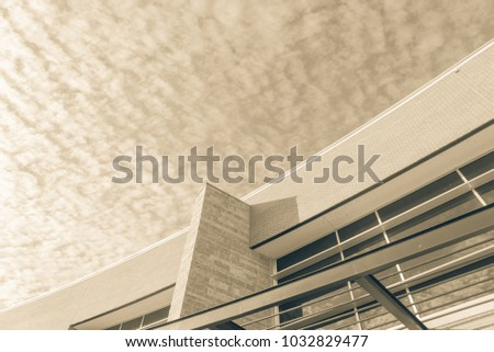 Office building facade again altocumulus cloud in America. Vintage look