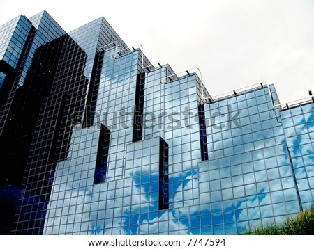 office building in London with reflection of clouds