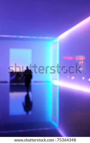 Office building lobby with purple light