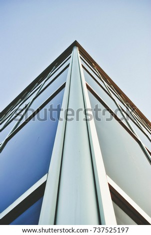 Office building on the background of a beautiful clear blue sky #737525197