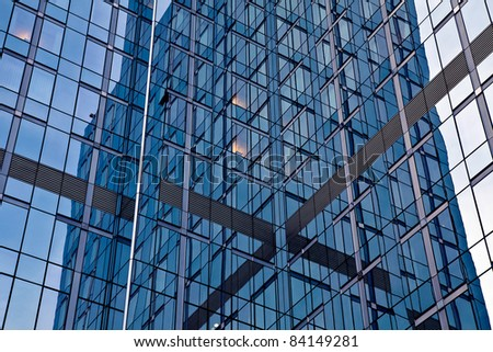 Office Building Reflections - Sails in Windows. Pattern of windows on a clear blue day. - Shutterstock ID 84149281
