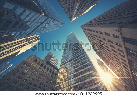 Photo of  Office building top view background in retro style colors. Manhattan buildings of New York City center - Wall street