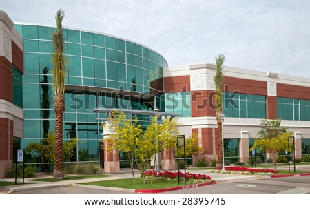Office building with flowers and trees.