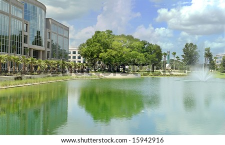 Office building with pond and fountain.