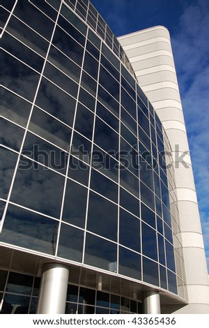 office building with reflection of clouds