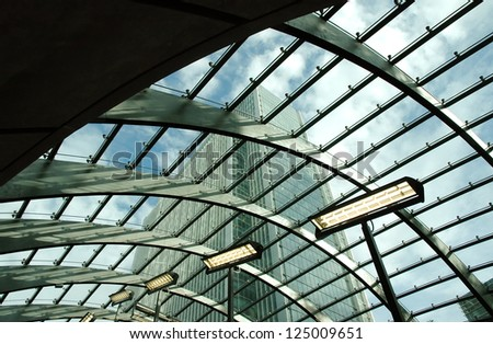 Office buildings in Canary Wharf seen from london tube station glass roof