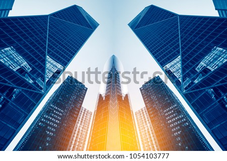 Office buildings in Paris business district La Defense. Skyscrapers glass facades. Modern urban architecture, economy, finances, business activity concept illustration. Abstract background. #1054103777