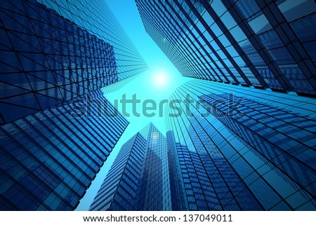 Office buildings on a background of the blue sky and solar flare