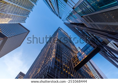 Office buildings stretch up to the blue sky in the financial district in downtown Toronto Ontario Canada.