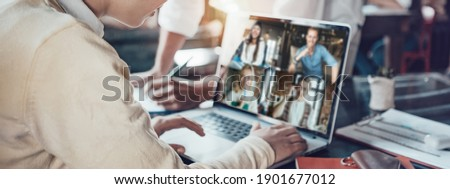 Office business team concept. Video conference using laptop with remote working teammates. Wide screen orientation Stockfoto ©