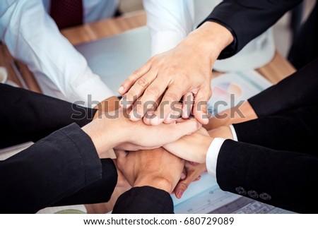 office businessman team cheerful motivation join hand group teamwork after meeting #680729089