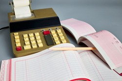 Office calculator, ledger and check book