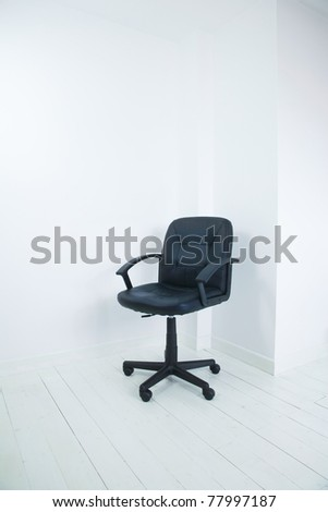 office chair in the corner of a empty room - stock photo