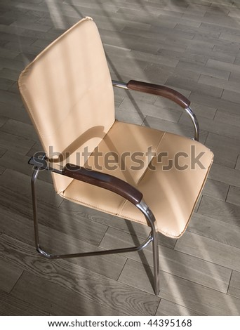 Office chair on the wooden floor. Subjects of office interiors.
