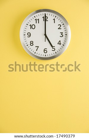 Office Clock Displaying 5 O'clock - stock photo