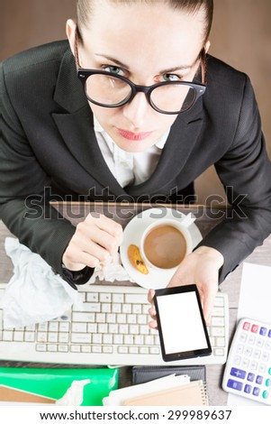 Office Coffee break on Workplace at the table. chatting mobile Phone. Girl with glasses office worker lunch. Desk untidy. White background on the monitor, you can place your information. Top view