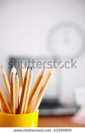 office concept with different pencils in close up, selective focus on nearest