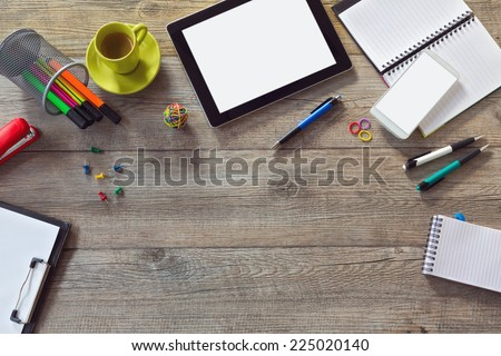 Office desk background with tablet, smart phone and cup of coffee. View from above with copy space