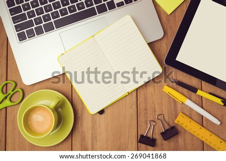 Office desk mock up template with laptop, notebook and tablet. View from above