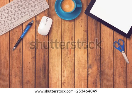 Office desk mock up template with tablet, keyboard and coffee on wooden background