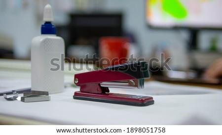 Office desk, stapler on the desk and glue in a tube, staples for the stapler. Office tools Photo stock ©