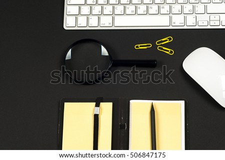 Office desk table with computer, books, a magnifying glass and pen. Top view with copy space. Corporate stationery branding mock-up #506847175