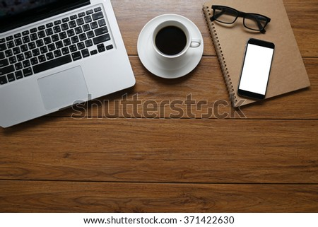 Office desk table with computer, supplies and coffee cup, phone, book, Top view with copy space #371422630