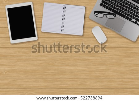 Office desk table with computer, supplies, ipad,smartphone,coffee cup on wooden background. Top view with copy space