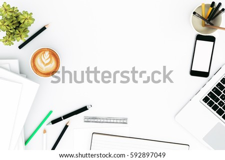 Office desk table with labtop computer,blank magazinesmart phone and coffee cup Top view with copy space,3D rendering