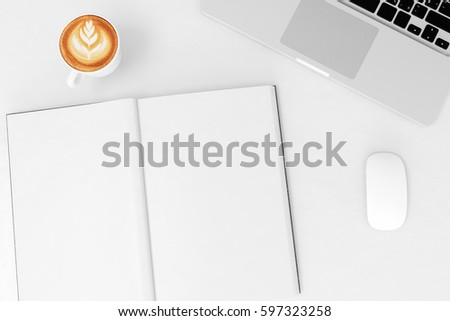 Office desk table with labtop computer,blank magazinesmart phone and coffee cup Top view with copy space,3D illustration