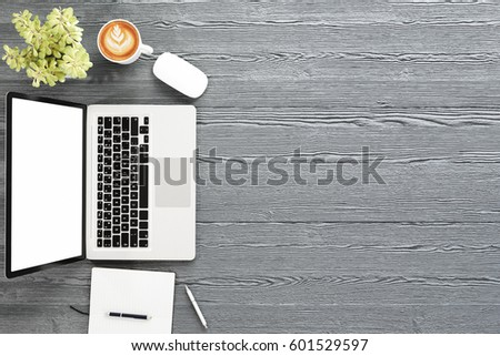 Office desk table with labtop computer,blank screen mockup and coffee cup. Top view with copy space for design,3D illustration