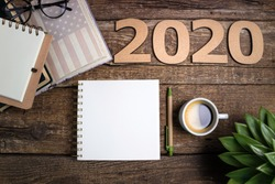 Office desk table with notebooks, coffee cup, american flag. New year 2020 resolutions or goals list. Goal, plan, strategy, politics, international relations, economics, american history concept