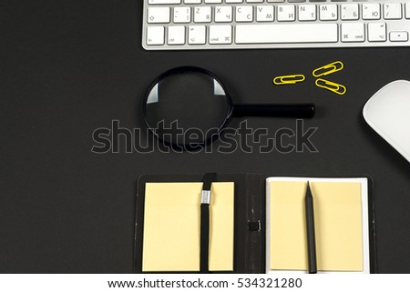 Office desk table with white computer, supplies. Top view with copy space #534321280