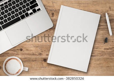office desk top view with blank notebook
