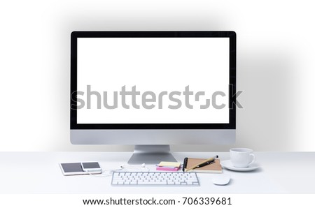 Office desk with computer screen, keyboard, mouse, stationary and coffee cup #706339681