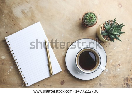 Office desk with hot coffee, plant, eyeglasses on beige stone background. Business desk minimal style concept with copy space. Top view. Flat lay #1477222730