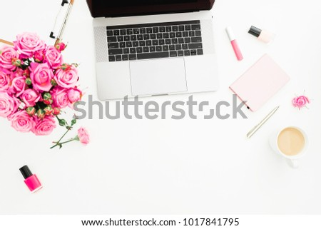 Office desk with laptop, pink roses bouquet, coffee mug, pink diary on white background. Flat lay. Top view. Fashion or freelance concept with copy space #1017841795