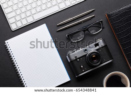 office desk with photo camera ...