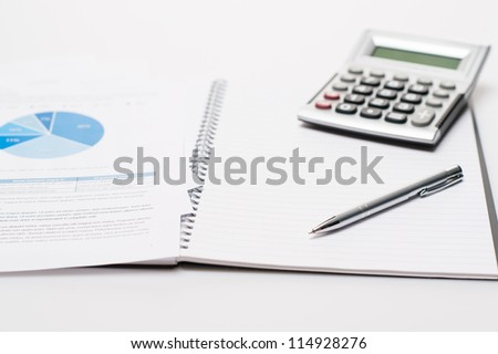 Office desk with supplies business silver pen on open notepad