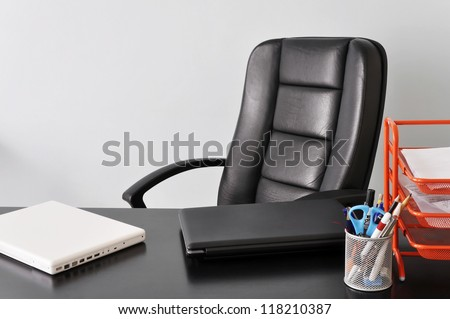 Office desk with two laptops, job or business concept