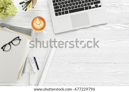 Office desk wood table with labtop computer,blank magazine smart phone eyeglasses and coffee cup Top view with copy space,3D rendering