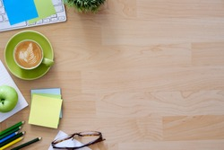 Office desktop with office accessories, Desktop with business objects and snack foods.Hero header Concept.