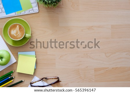 Office desktop with office accessories, Desktop with business objects and snack foods.