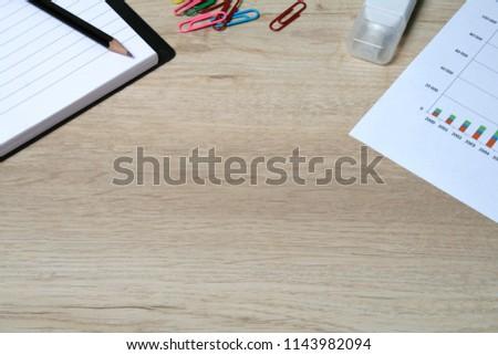 Office desktop with office accessories, Desktop with business objects. Business objects on wood work table. #1143982094