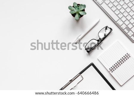 office flat lay with keyboard, glasses, notebook on white background top view mockup