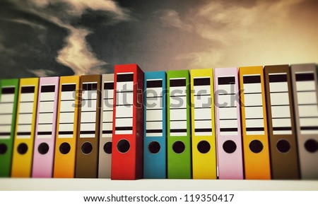 office folders under a cirrus sky